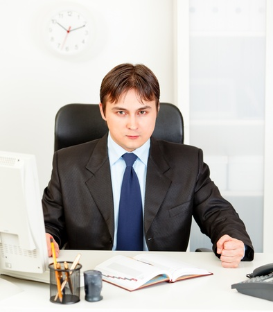 banging: Dissatisfied modern business man banging fist on table  Stock Photo