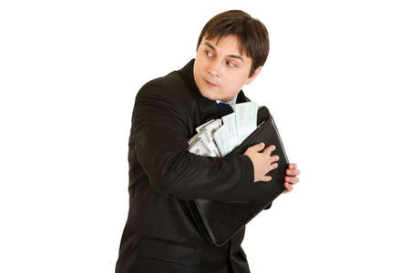 circumspect: Worried businessman hugging briefcase with money in hands