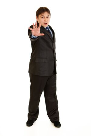 Full length portrait of scared young businessman isolated on white   photo