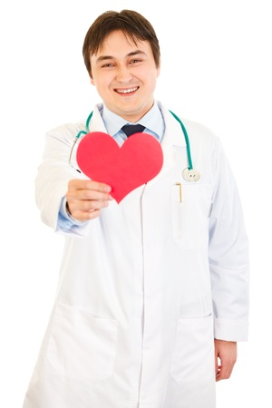 Smiling medical doctor holding heart shape paper in hand   photo