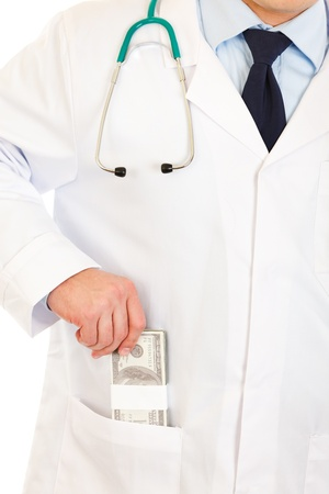 doctor putting money: Medical doctor putting  money in pocket