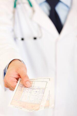Doctor holding medical prescription Stock Photo - 8843335