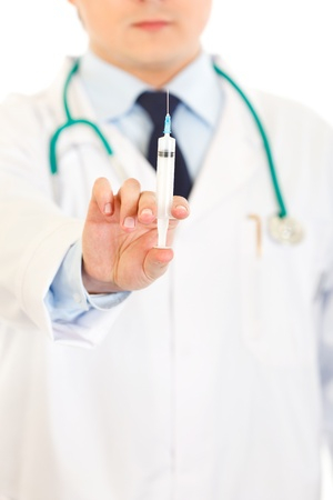 Doctor with medical syringe in hands isolated on white. Close-up.  Stock Photo