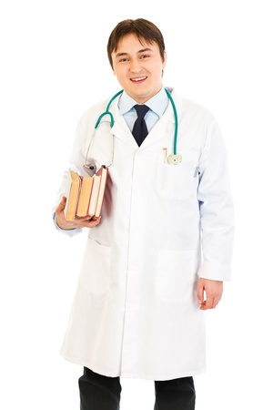 Smiling  doctor holding several medical books in hands   Stock Photo - 8842524