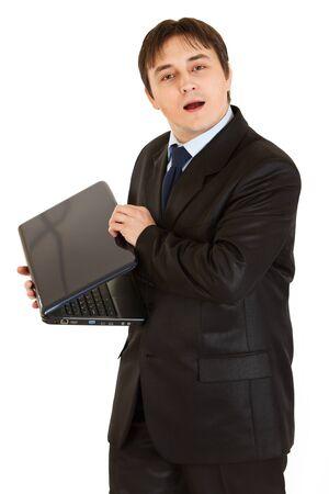 Secretive modern businessman hiding laptop screen  photo