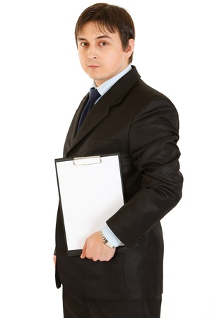 Pensive modern businessman holding blank clipboard   Stock Photo - 8845986