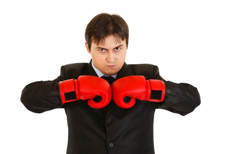 Angry young businessman with boxing gloves   photo