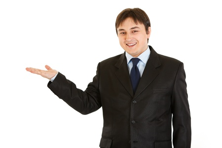 Smiling young  businessman presenting something    photo