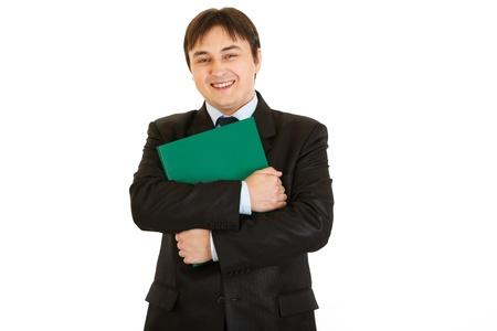 Smiling  businessman hugging  folder with documents  photo