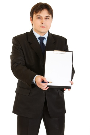 Serious modern businessman with documents and pen  photo