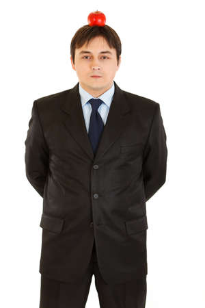 centrality: Young businessman with apple on his head  Stock Photo