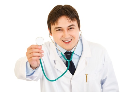 Smiling young medical doctor  holding up stethoscope  photo
