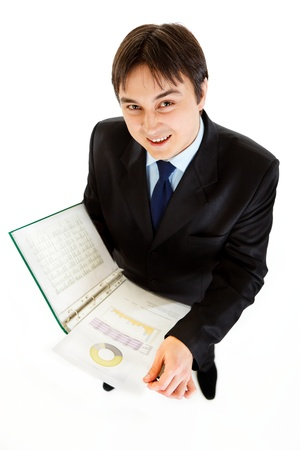 Smiling modern businessman with folder in hand exploring financial document isolated on white  photo