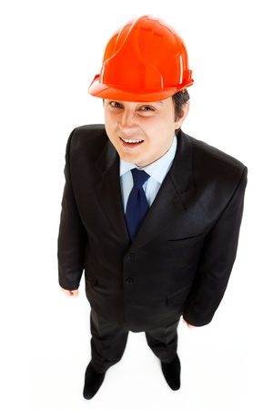 Smiling businessman with helmet on head  photo