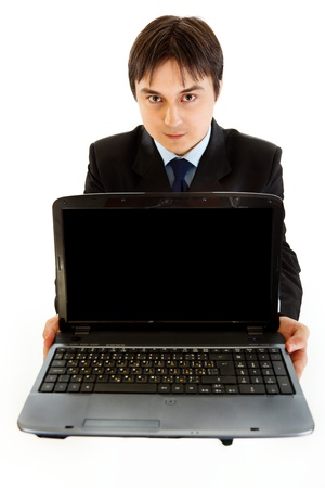 Smiling businessman holding laptops blank screen   photo