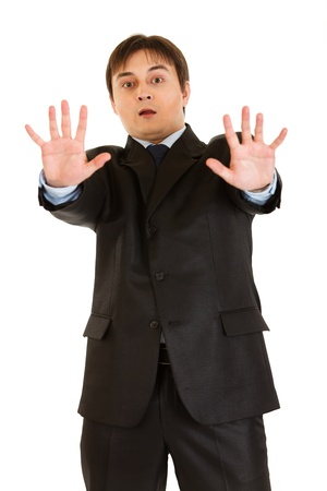 Portrait of scared young businessman   photo