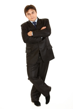 Full length portrait of businessman leaning against something  photo