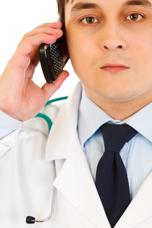 Medical doctor talking on mobile phone   photo