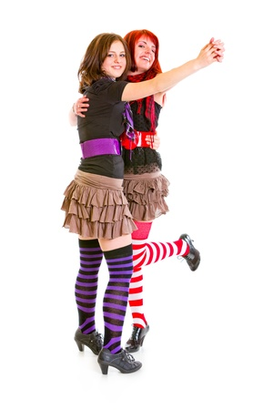 Two cheerful young girlfriends dancing for fun  Stock Photo - 8847499