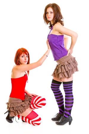 to implore: Cute girl on knees begging her girlfriend   Stock Photo