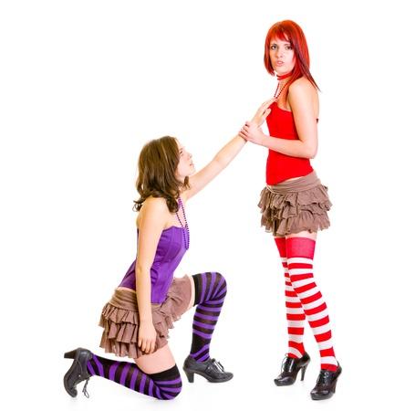 Cute girl on knees begging her girlfriend Stock Photo - 8847501
