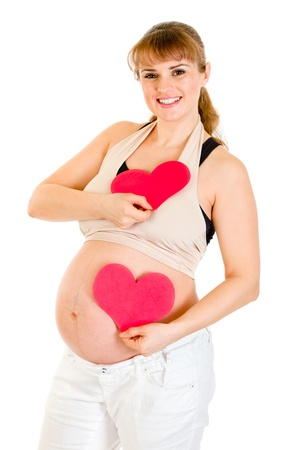 Happy pregnant woman holding two paper hearts Stock Photo - 8848154