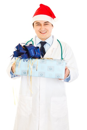 amiable: Smiling medical doctor in Santa hat holding present