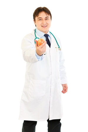 Smiling  medical doctor holding apple photo