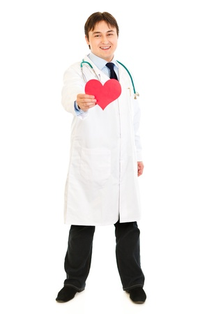 Smiling medical doctor holding paper heart Stock Photo - 8848280