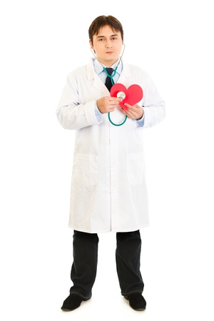 certitude: Authoritative medical doctor holding stethoscope on a heart paper shape