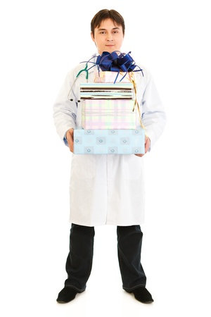 Smiling medical doctor holding gifts photo