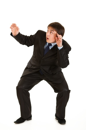 appalled: Full length portrait of scared young businessman isolated on white   Stock Photo