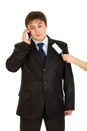 chiefs: Secretary cleaning  chiefs suit while he talking on telephone isolated on white  Stock Photo