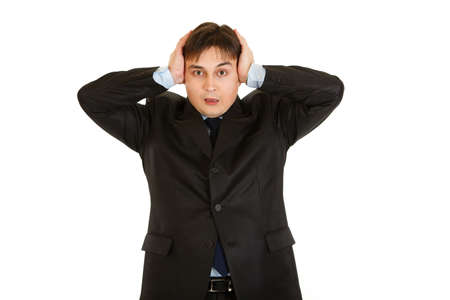 uptight: Stressed modern businessman with hands near head  isolated on white  Stock Photo