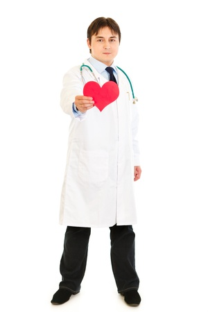 Smiling medical doctor holding paper heart in hand  isolated on white Stock Photo - 8931995