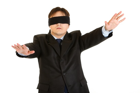 disoriented: Disoriented businessman with blindfold covering his eyes  isolated on white