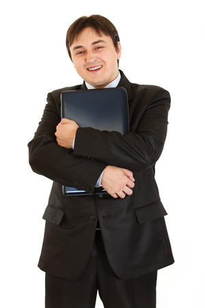 Smiling  modern businessman hugging  laptop  isolated on white Stock Photo - 9024852