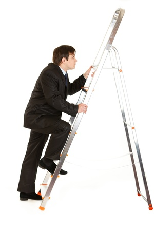 Modern businessman  climbing upwards up on ladder isolated on white