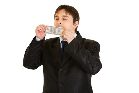 delightfully: Modern businessman delightfully sniffing hundred dollar banknote isolated on white