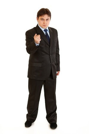 wrathful: Wrathful modern businessman pointing finger at you isolated on white
