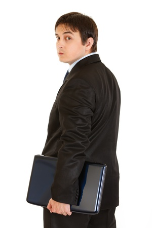 Serious modern businessman holding laptops in hand isolated on white  photo