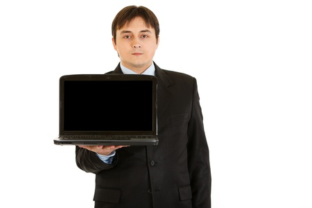 blank screen: Young businessman holding laptop with blank screen isolated on white