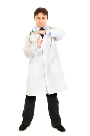 Authoritative medical doctor with time out crossed arms isolated on white