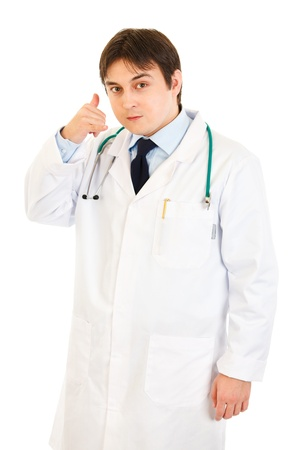 authoritative: Authoritative medical doctor showing contact me gesture isolated on white