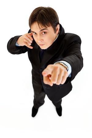 authoritative: Authoritative modern businessman showing contact me gesture isolated on white  Stock Photo
