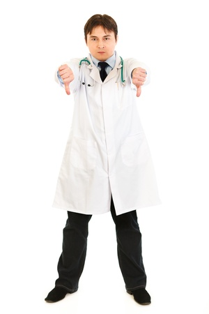 malcontent: Displeased medical doctor showing thumbs down gesture isolated on white