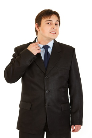 strenuous: Stressful businessman pulling collar of his shirt isolated on white  Stock Photo
