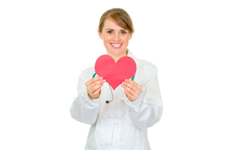 Smiling medical female doctor holding paper heart in hands isolated on white Stock Photo - 9245135