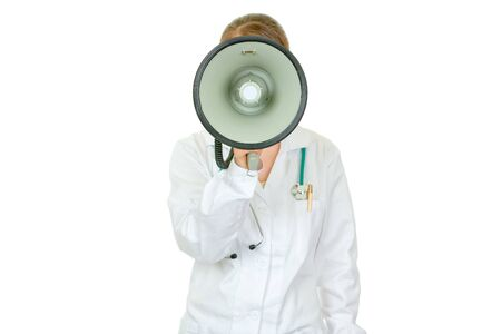 Medical doctor woman  standing in front of camera and speaking into megaphone isolated on white Stock Photo - 9245134
