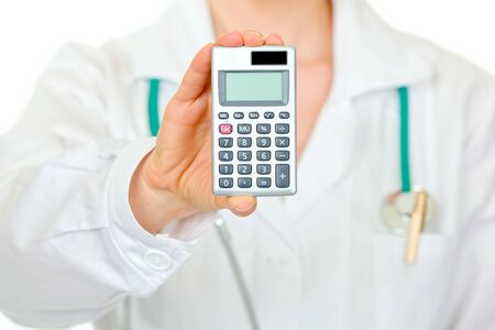 Medical female doctor holding calculator with blank screen isolated on white. Close-up 